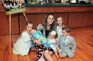 Ashlee and her five children at her husband's funeral