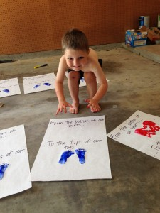My 4-year old getting ready to make his heart out of handprints.